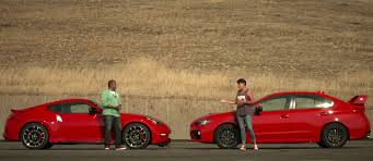 nissan 370z vs mustang gt nissan 370z nismo takes a beating from the subaru wrx sti
