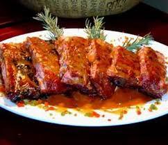 cuisiner travers de porc recette de travers de porc grillés marinés à l orange recettes