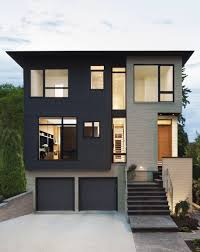 simple black and cream wall modern houses exterior with warm lamp