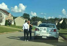 officer teaches teen to tie his tie for homecoming dance