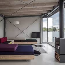 stay in a modern houseboat in berlin with floor to ceiling windows