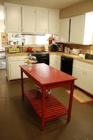 red stained wooden island on brown concrete flooring combined with
