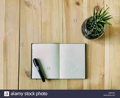 The Book Is On The Table Sketch Book On The Table Open Sketch Book Is Lying On A Wooden