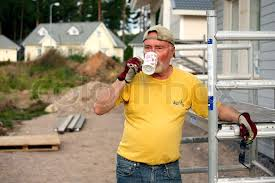 house builder senior house builder taking coffee outdoors stock photo