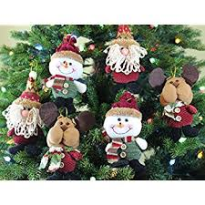 Christmas Decoration Images Amazon Com Christmas Snowman Top Of The Tree Hugger Home U0026 Kitchen