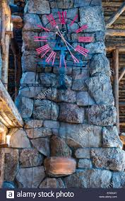 the giant clock in front of the stone fireplace inside old