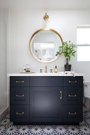 best 25 navy blue color ideas on pinterest navy blue paints navy cabinet with white countertop and gold mirror in a bathroom