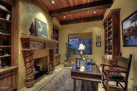 mediterranean home office with built in bookshelf u0026 high ceiling