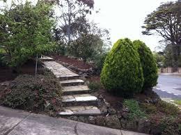 rocks in the landscape u2013 grass trees u0026 butterfly chairs