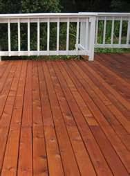 pressure treated lumber front porch stained with defy extreme
