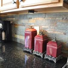 Granite Countertops And Tile Backsplash Ideas Eclectic by Uba Tuba Granite Countertop With A Scabos Tile Backsplash Cut Into