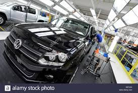 volkswagen germany mechanics work on the new models of the vw amarok in hanover stock