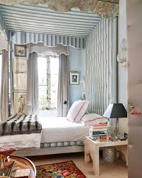 home tour miles redd s eclectic new york townhouse how to decorate miles redd s bedroom features a canopy bed lined in striped silk gray silk drapery panels