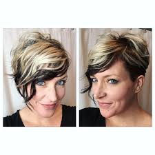 very short pixie hairstyle with saved sides short hair undercut pixie cut curls shaved sides assymetrical