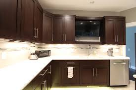 kitchen cabinets above sink tv above kitchen sink flanked by cabinets