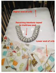 Baby Cribs And Mattresses How To Elevate Crib Mattress And Keep Baby From Rolling Everywhere