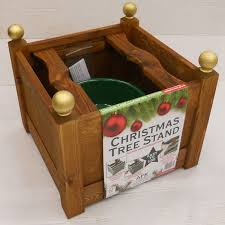christmas tree stands classic wooden christmas tree stand beech charlies direct