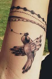 make tattoo necklace images Kristen may band bird jewelry upper arm tattoo steal her style jpg
