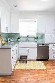 white kitchen cabinets with aqua backsplash image result for kitchen concrete countertops aqua glass