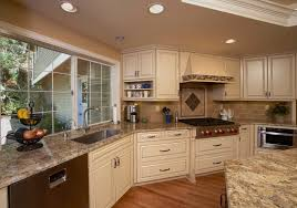 beautiful kitchen granite is golden beach with a travertine