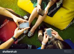 group three young people using smartphones stock photo 605089166 group of three young people using smartphones together modern lifestyle or communication technology gadget concept