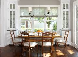 traditional kitchen banquette seating with wooden floor and white