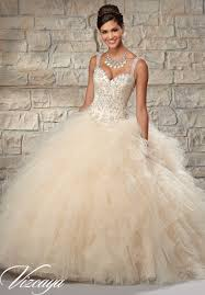 quinceanera dresses with straps embroidered and beaded bodice on a ruffled tulle skirt quinceanera