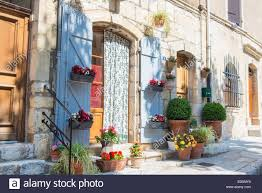 typical french house with flowers and plants outdoor stock photo