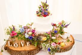 wedding flowers on a budget uk rustic cake table see page http www confetti co uk real