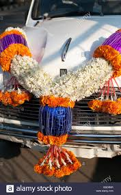 hindu garland traditional hindu flower garland on the bonnet of an indian taxi