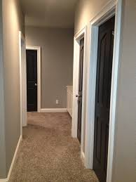 grey walls and black doors rare to find a photo with carpet