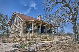 log cabin in the texas hill country landscape architecture by