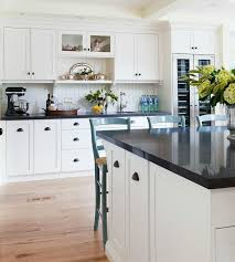white kitchen cabinets and black quartz countertops two tone black and white kitchen features white cabinets