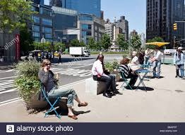 Outdoor Sitting Area Diverse People Enjoy Outdoor Public Seating Area On Broadway At