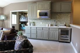 gray bonus room wet bar cabinets with wine refrigerator by burrows