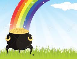 pot of gold on the grass at the end of a rainbow royalty free