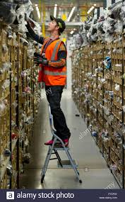 amazon photography black friday stock pickers in the amazon fulfillment centre warehouse in