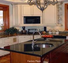 granite countertop granite and white cabinets water leak from
