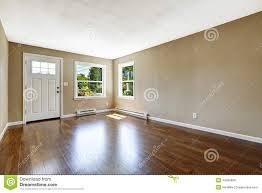 Empty White Bedroom Empty House Interior Hardwood Floor And Beige Walls Stock Photo