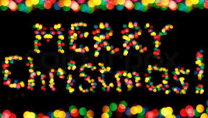 colorful garland lights looking as words merry
