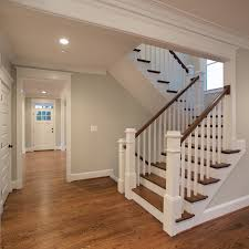 the beautiful u shaped stair has hardwood treads and handrails