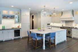 white kitchen island with curved marble countertop and blue