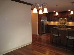 Kitchen With Wood Floors by Solid Hickory Walnut Madrone Wood Flooring By Muscanell