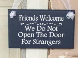 friends welcome we do not open the door for strangers wood