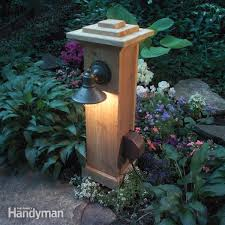 How To Install Landscape Lighting How To Install Outdoor Lighting And Outlet Family Handyman