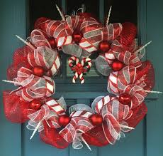 wire wreath frame covered with red and white mesh intertwined with