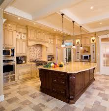 design beige kitchen with a large island high end kitchen ranges