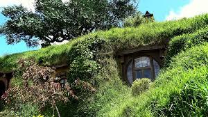 hobbit hole hobbit hole house with blue door at hobbiton new zealand 4k prores