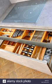 two organised and tidy modern kitchen drawer interiors with