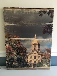 notre dame golden dome in the fall barkside wood photo